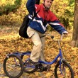 Stock Photo: Portrait Of down syndrome MWith Cycle In Autumn Park