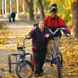 Down syndrome couple on bikes - Photo
