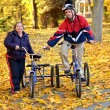 Down syndrome couple on bikes — Stock Photo #7459104