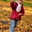 Little baby in an autumn park — Foto de stock #7459108