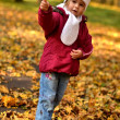 Little baby in an autumn park — Stockfoto #7459108