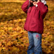 Young girl with camera in autumn park — Stock Photo #7459136