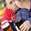 Down syndrome couple drinking - Stock Photo
