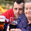 Down syndrome couple drinking — Stock Photo #7459150