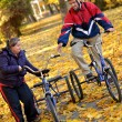 Down syndrome couple on bikes — Stock Photo #7459164