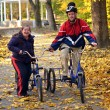 Down syndrome couple on bikes — Stock Photo #7459165