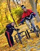 Down syndrome couple on bikes — Stock Photo