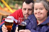 Down syndrome couple drinking — Stock Photo