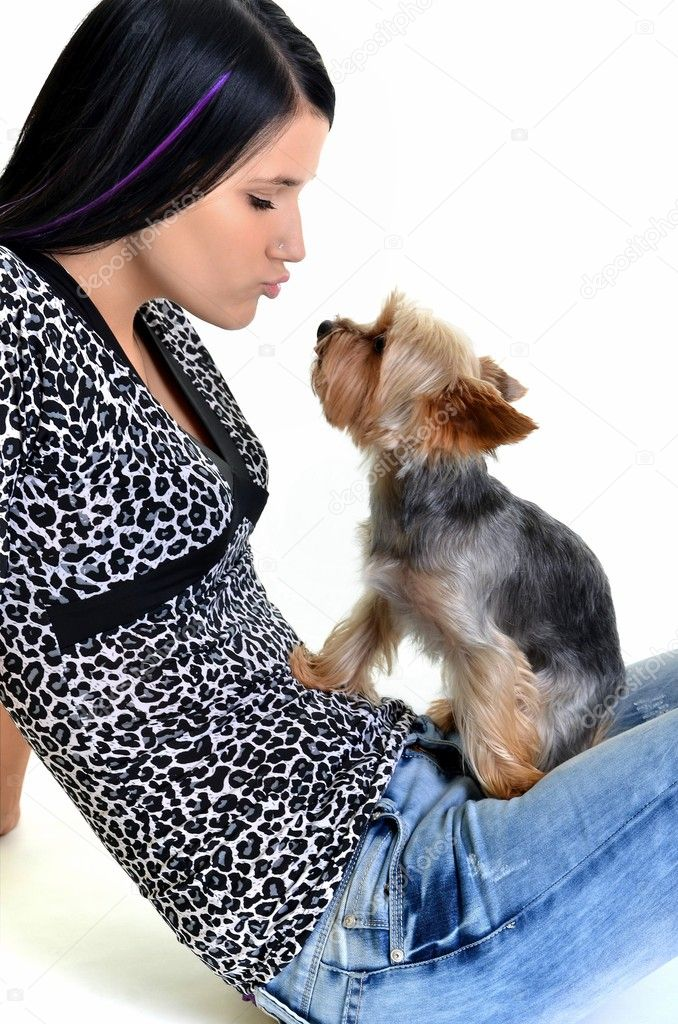 Cheerful young woman playing with her puppy. Isolated on white background — Stock Photo #7458975
