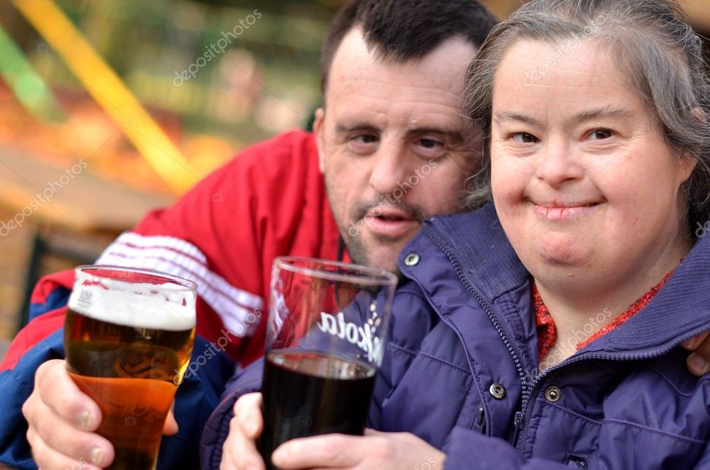 http://static7.depositphotos.com/1211672/745/i/950/depositphotos_7459150-Down-syndrome-couple-drinking.jpg