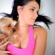 Young woman and sweet puppy playing around — Stock Photo #7463347