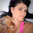 Young woman and sweet puppy playing around — Stock Photo #7463353