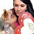 Young woman and sweet puppy with gingerbread heart — Stockfoto