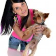 Stock Photo: Young woman and sweet puppy playing around