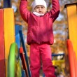 Baby in an autumn park — Stock Photo #7521723
