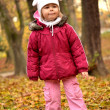Baby in an autumn park — Stock Photo