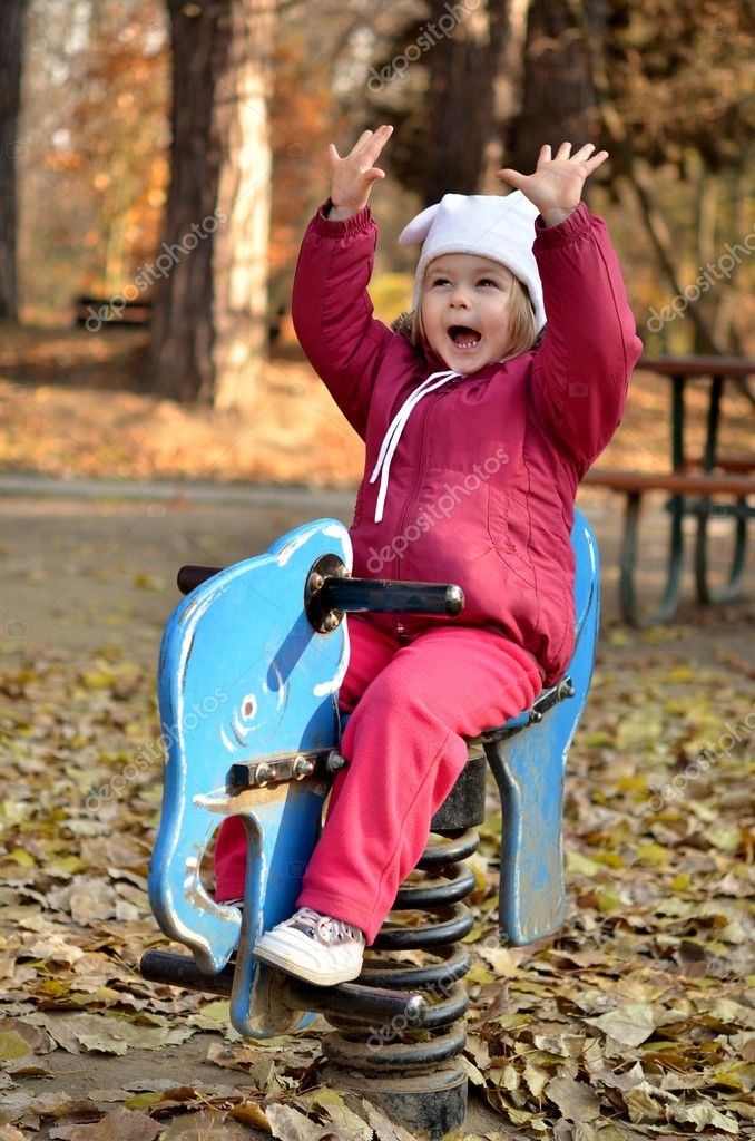 	Nice little baby in an autumn park   Stock Photo #7521702