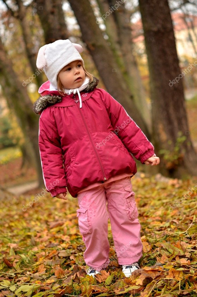 Nice little baby in an autumn park  — Stock Photo #7521756