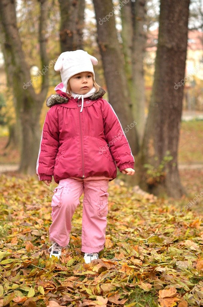 	Nice little baby in an autumn park   Stock Photo #7521769