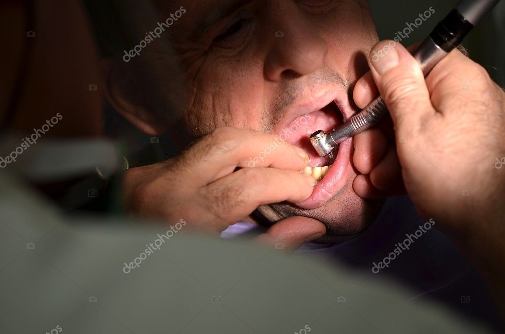 	Medical treatment at the dentist office  Stock Photo #7534209