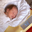 Baby on weight scale — Stock Photo #7621463
