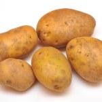 einige gelbe Kartoffeln isoliert auf weißem Hintergrund — Stockfoto #7674883