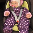 Little baby in a car in a child`s car seat - Stock Photo