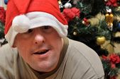 Handicapped man with santa hat — Stock Photo
