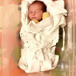 Newborn baby in open plastic box — Stock Photo