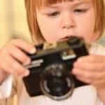 Baby with camera — Stock Photo #7723827