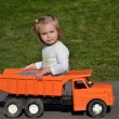 Stock Photo: Baby playing with toy car