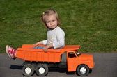Baby playing with toy car — Stock fotografie
