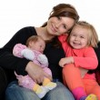 Picture of happy mother with her daughters over white — Stock Photo