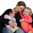 Picture of happy mother with her daughters over white — Stock Photo #7854847