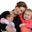 Picture of happy mother with her daughters over white — Stock Photo #7854853