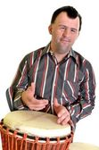 Happy man with down syndrome playing on drum. — Stock Photo