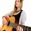 Hippie girl with the guitar isolated on white background — Stock Photo
