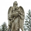 Sculpture of an angel with a child — Stock Photo