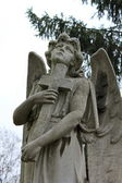 Sculpture of angel with cross — Stock Photo