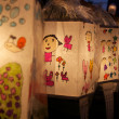 Paper lanterns decorated with drawings made by children — Stock Photo