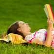 Royalty-Free Stock Photo: Beautiful woman reading in the park