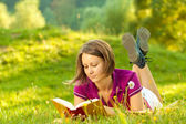 Beautiful woman enjoying a book — Stock Photo