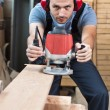 Stockfoto: Worker with router, vertical.
