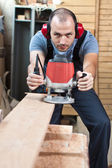 Worker with a router, vertical. — Stock Photo