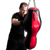 Boxer punching a sand bag — Foto de Stock