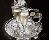 Party Serving Tray with sparkling champagne — Stock Photo