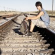 Teen boy on rail road — Stock Photo #7007599
