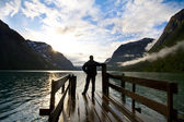 Silhouette of man looking on lake — Stock Photo