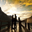 Silhouette of two lovers at mountain lake — Stock Photo #7020427