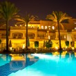 Night pool side of rich hotel — Stock Photo #7403754